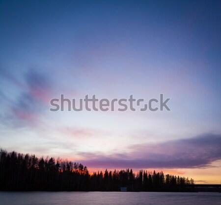 Longa exposição pôr do sol lago Finlândia nuvens abstrato Foto stock © Juhku