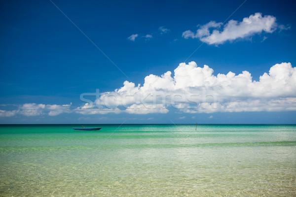 Rybak łodzi turkus wody dzień plaży Zdjęcia stock © Juhku