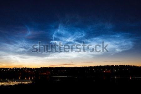 Beautiful sky phenomenon noctilucent clouds Stock photo © Juhku