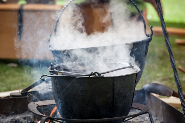 Soup cooking in medieval pot Stock photo © Juhku
