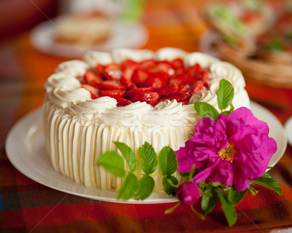 Delicious strawberry cake on coffee table Stock photo © Juhku