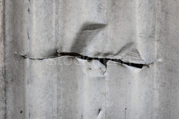 Cut in corrugated metal sheet Stock photo © Juhku