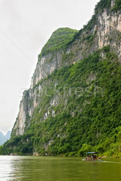 Grande calcário penhasco bambu barco rio Foto stock © Juhku