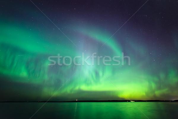 Stock photo: Northern lights over lake in finland