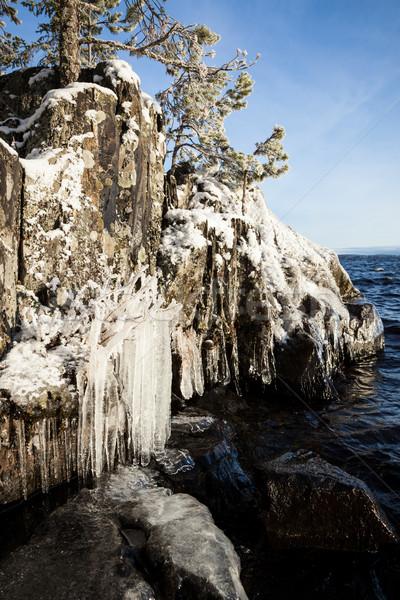 凍結 岩 崖 日の出 光 水 ストックフォト © Juhku