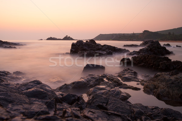 Sunset at om beach india Stock photo © Juhku