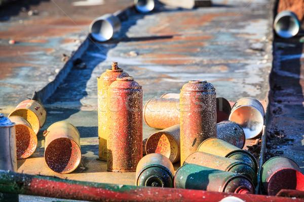 Használt graffiti spray fektet körül tető Stock fotó © Juhku