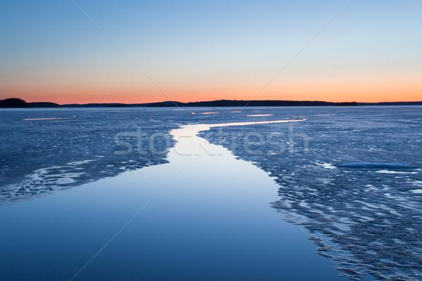 Serene frozen lake scape at twilight Stock photo © Juhku