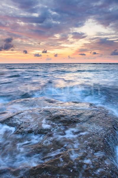 Longa exposição mar rochas crepúsculo marinha água Foto stock © Juhku
