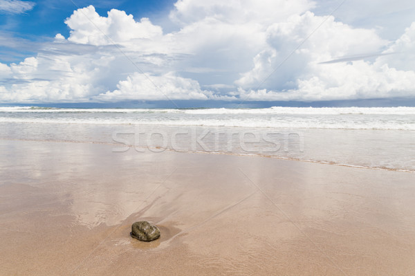 Waves sand beach and clouds sunny day Stock photo © Juhku