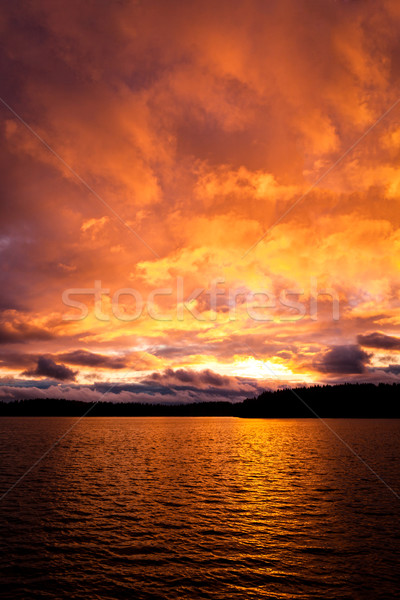 Сток-фото: драматический · огня · красный · закат · озеро · облака