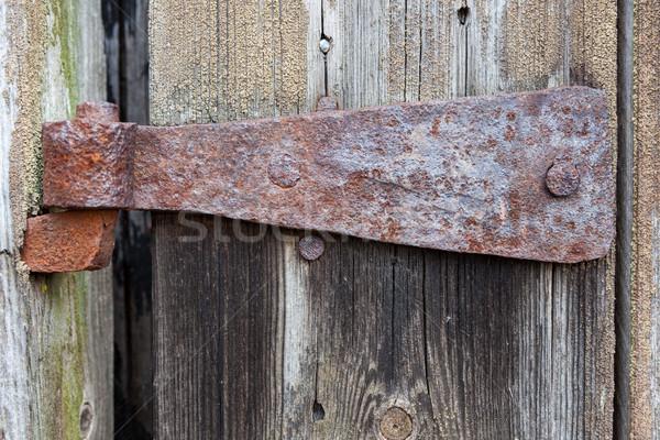 Velho enferrujado dobradiça celeiro porta textura Foto stock © Juhku
