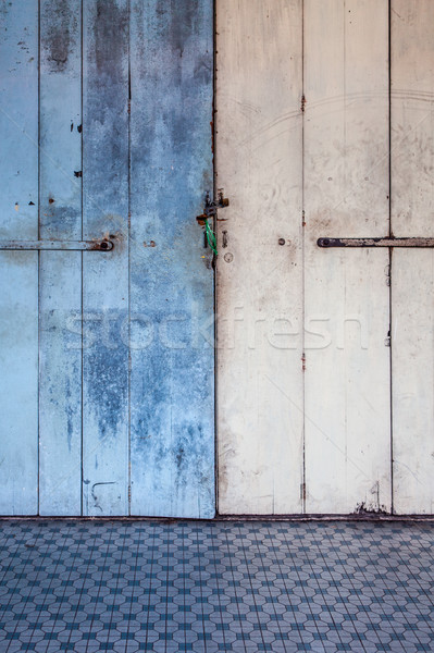 Worn old wooden door locked Stock photo © Juhku