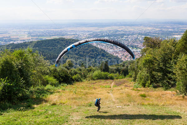 Paraglider running for take off Stock photo © Juhku