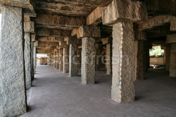 Stone pillar long corridor in hampi Stock photo © Juhku