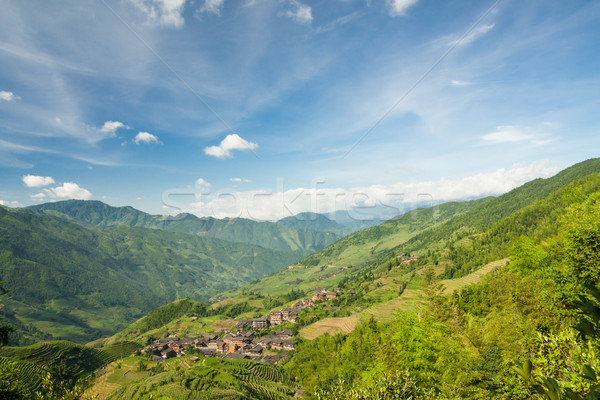 Landscape photo of rice terraces and village in china Stock photo © Juhku