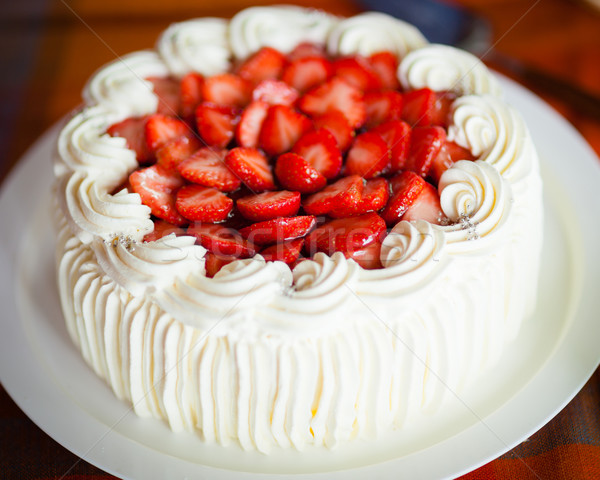 Delicious strawberry cake with strawberries and whipped cream Stock photo © Juhku