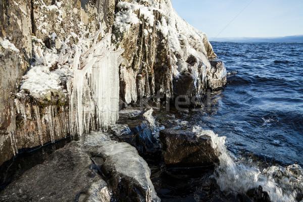 ストックフォト: 凍結 · 岩 · 崖 · 日の出 · 光 · 空