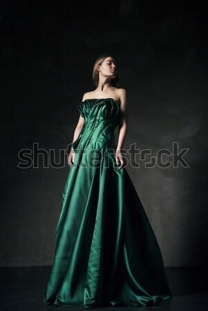 Modell pózol zöld divat ruha gyönyörű Stock fotó © julenochek