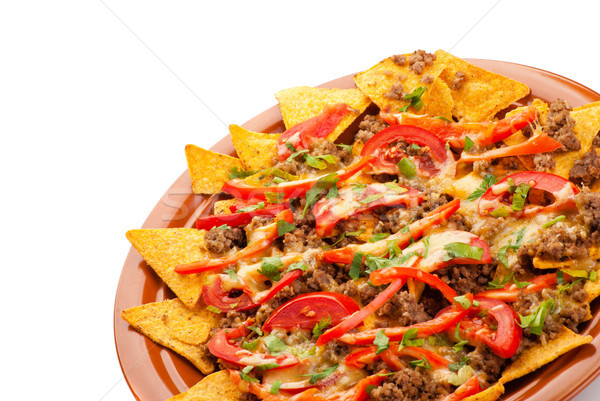 spicy nachos with pork, tomato and pepper Stock photo © julenochek