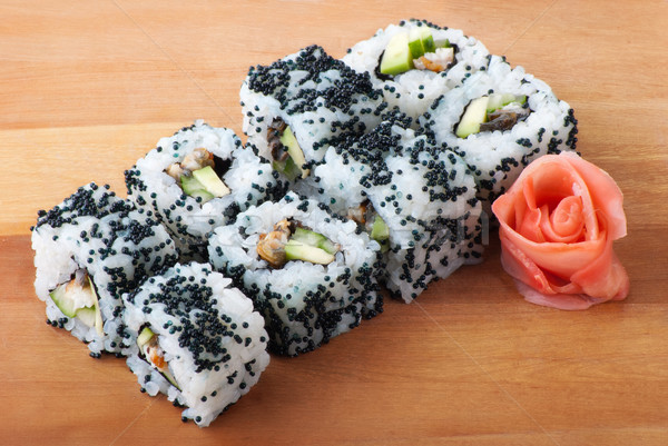 california sushi rolls on wooden plate Stock photo © julenochek