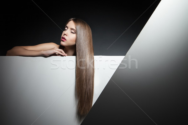 Beautiful brunette with long hair and eyes closed Stock photo © julenochek