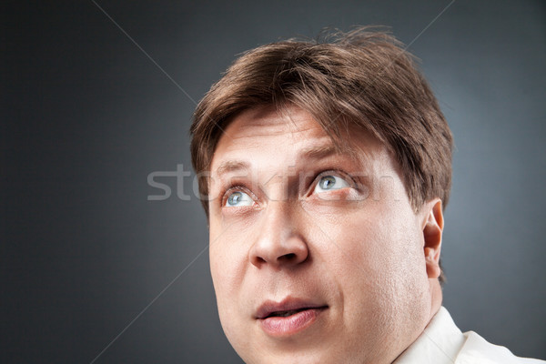 Close-up of adult man looking up in amazement Stock photo © julenochek