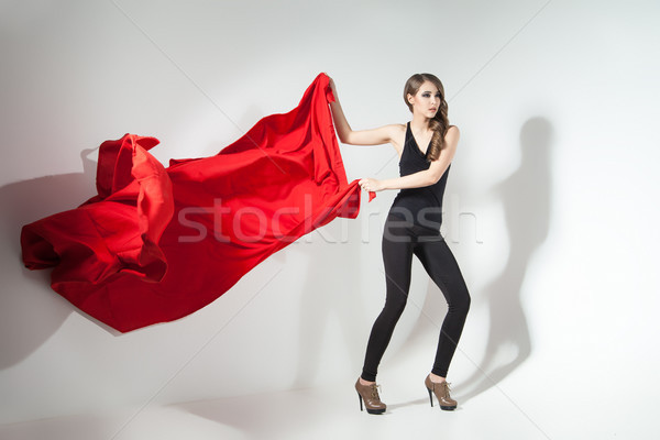Stock photo: Girl holding red cloth waving