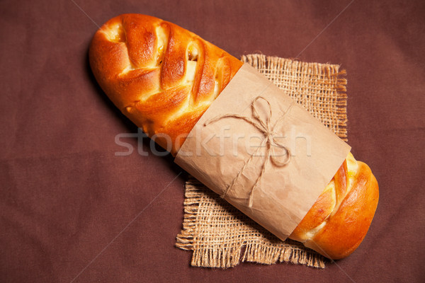 Poppy roll on brown napkin Stock photo © julenochek