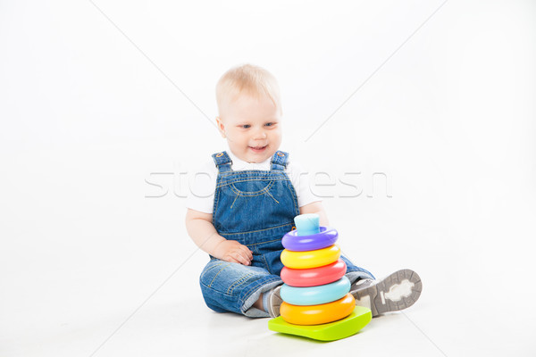 Adorable toddler playing with toy Stock photo © julenochek