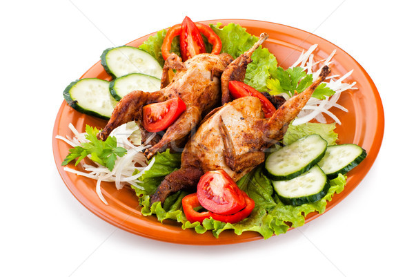 Two whole quail with cucumber, tomatoes and onion Stock photo © julenochek