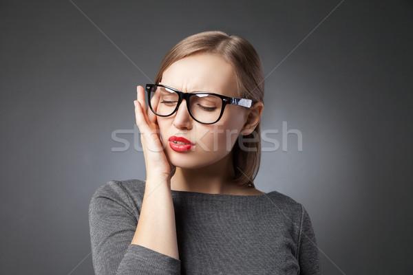 Beautiful young woman portrait. Headache or depression Stock photo © julenochek