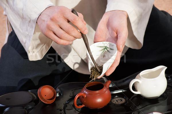 Fiatalember kínai tea szertartás mester kimonó Stock fotó © julenochek