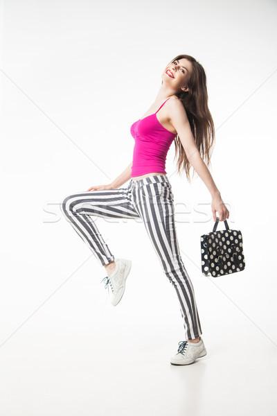 Glimlachend model zak springen Stockfoto © julenochek