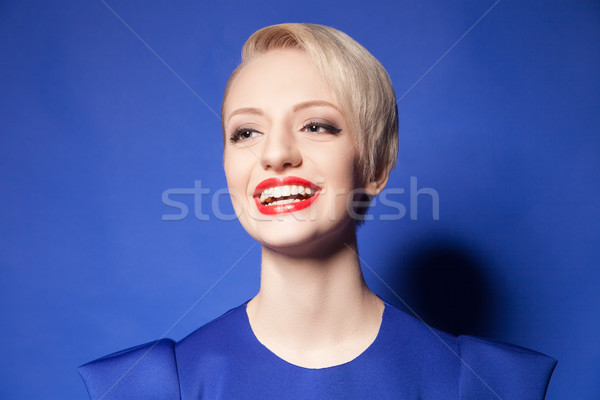 Happy blonde girl with short hair and red lips Stock photo © julenochek