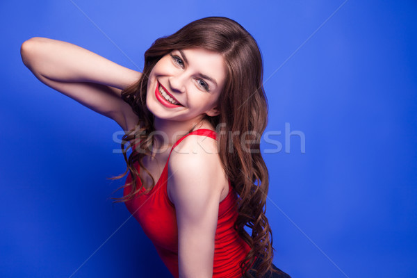 Attractive young brunette with red lips smiling at camera Stock photo © julenochek