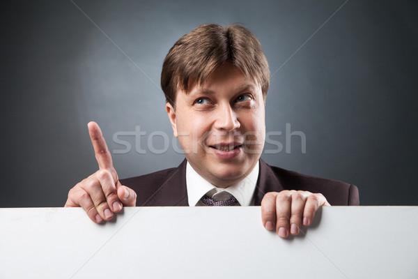 Zakenman wijsvinger omhoog portret volwassen Stockfoto © julenochek