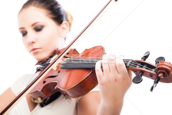 Beautiful young woman playing violin over white Stock photo © julenochek