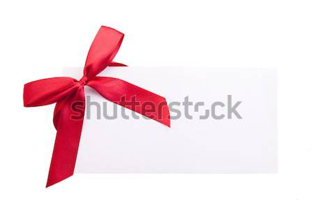 Card note with red ribbon on white background Stock photo © julenochek