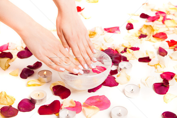 Female gentle hands on bowl with water Stock photo © julenochek