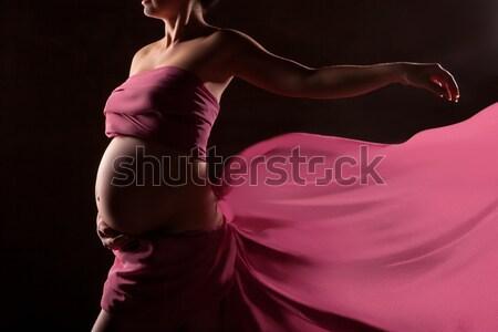 Beautiful pregnant woman in pink chiffon shawl Stock photo © julenochek