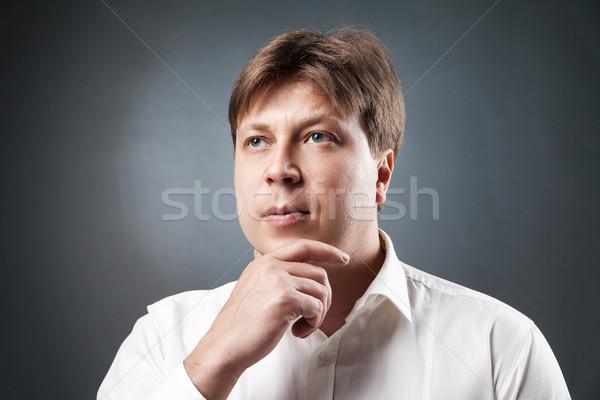Retrato pensativo caucásico hombre adulto Foto stock © julenochek