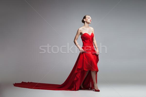 Young model in long red dress Stock photo © julenochek
