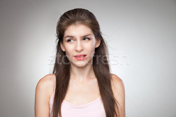 Messed up girl biting her lips. Stock photo © julenochek