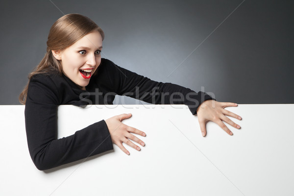Surprised woman with open mouth loooking down Stock photo © julenochek