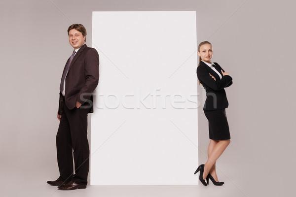 Homem de negócios mulher em pé bandeira de volta tanto Foto stock © julenochek