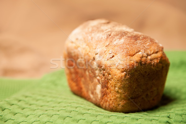 Loaf of grey wheat rye bread on napkin Stock photo © julenochek