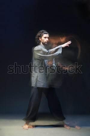 Man in kimono excercising Martial Arts Stock photo © julenochek