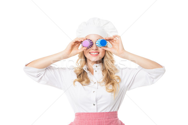 Woman in chef uniform covers eyes with baking form Stock photo © julenochek