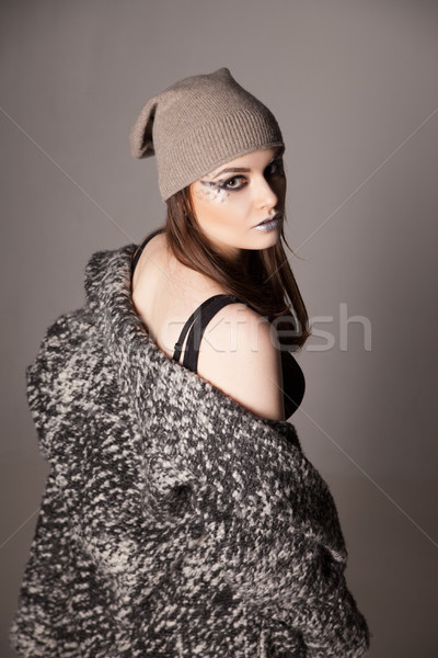 young woman turned looking over her shoulder .  Stock photo © julenochek